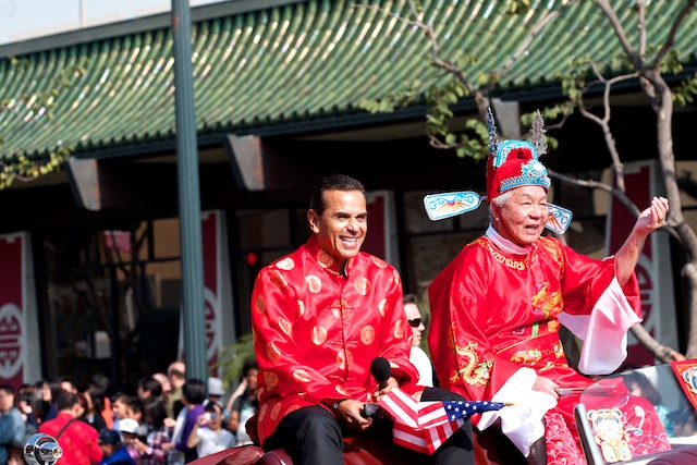 Los Angeles Mayor Antonio Villaregosa leads off the parade with this year's  grand marshall.