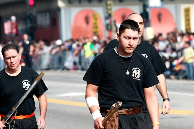Members of Tai Mantis Kung-Fu Academy march down the parade route.