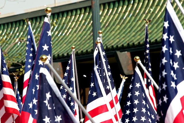 Members of a Rotary club carry American flags while marching in the 2011 Golden Dragon Chinese New Year Parade.