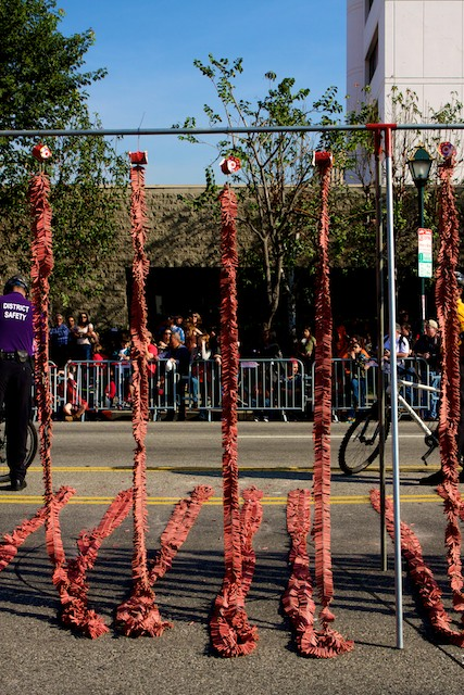 Ropes of firecrackers waiting to be lit at the closing of the 2011 Golden Dragon Chinese New Year Parade.