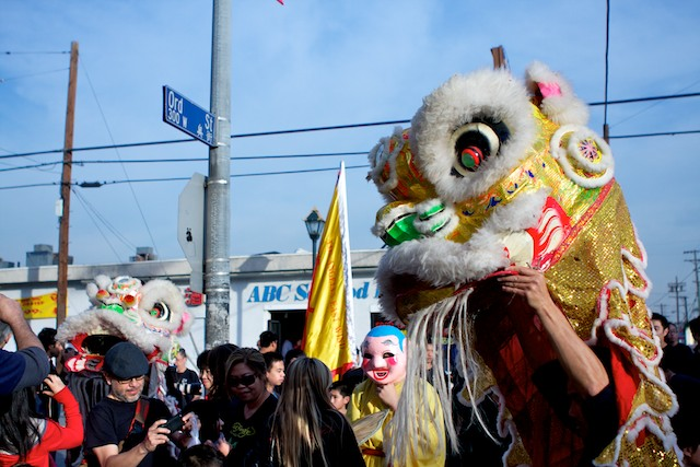 A Chinese lion perpares to enter a restaurant as part of Chinese New Year traditions in Chinatown.