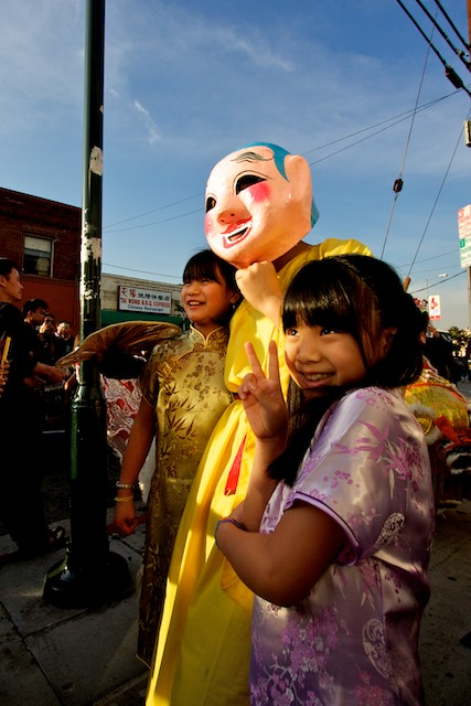 Children pose with the big head buddha.