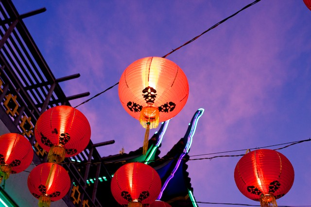 Lanterns glow at dusk in the main plaza of Chinatown.
